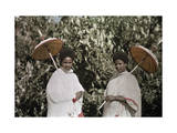 Two Amharic Women Pose Holding Umbrellas to Shade Themselves