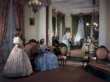 Women in Period Costumes Sit in an Antebellum Mansion's Drawing Room