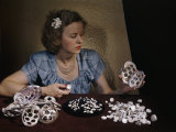 Woman Holds Mussel Shells and Pearl Buttons Made from Those Shells