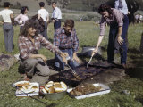 Women Turn Elk Stakes on a Grill