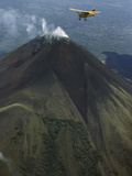 Plane Flies over a Smoking Volcano Called Momotombo
