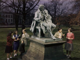 Students Stand Beside Statue of Thomas H Gallaudet on Campus Lawn