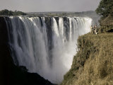 Tourists Look Small Against Backdrop of Victoria Falls