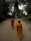 Buddhist Monks Approach the Side Entrance of the Angkor Wat Temples