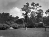 Man Plays Tennis at the Country Home of the Lowndes Family