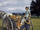 Children Sit in a Big-Wheeled Cart Loaded with Baskets of Tomato