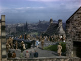 Tourists and Soldiers Walk in Edinburgh Castle Yard Overlooking City