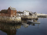 Picturesque Warehouses Store Fishing Gear on Stone Pilings on Shore
