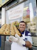 Owner of the Yonah Schimmel Knishery with a Tray of Knishes