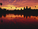 Silhouetted Temples and Reflections in Water at Sunset in Siem Reap