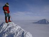 Polar Explorer Stands Atop Nemtinov Peak  Surrounded by Glaciers