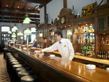 Bartender Wipes the Bar Counter in Raffles Hotel  Singapore