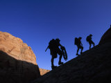 Silhouettes of Climbers Hiking in the Arizona Desert