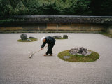 Young Monk Raking the Famous Japanese Rock Garden of Ryoanji Temple