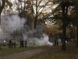 Students Gather by a Leaf Fire Outside a Dormitory at Bowdoin College