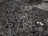 Elevated Scene of Crowds Crossing the Street at an Intersection