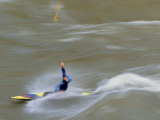 Kayaker Throws His Paddle in the Air Surfing a Standing Wave