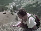 Woman Crawls to the Edge of a Cliff to Pick Edelweiss Flowers