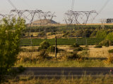 High Voltage Power Transmissions Lines Stretching into the Distance