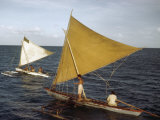 Men Sail Two Outrigger Sailboats across Abaiang Lagoon