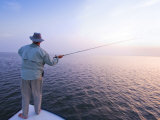 Fisherman Casts for Redfish at Laguna Madre on the Texas Gulf Coast