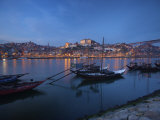 Boats Carrying Wine Barrels in Oporto Harbor at Dusk