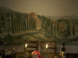 Dining Room Table with Tuscan Landscape Painted on Wall Behind