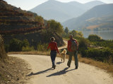 Couple with their Dog Hiking Along the Douro River
