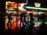 People Walking in Shenzhen on a Rainy Night