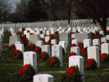 Christmas Wreathes Decorate the Headstones of Fallen Soldiers