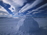 Igloo in a Desolate Arctic Landscape with Dramatic Clouds