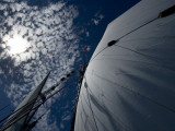 Looking Up the Mast of a Tall Ship to Cumulus Clouds in a Summer Sky