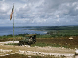 Soldier Sits in a Jeep on Hillside Overlooking Remains of Tinian Town