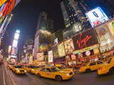 Taxi Cabs Fill Broadway at Night in Times Square
