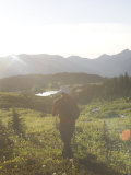 Man Walks Through the Rocky Mountains on a Summer Afternoon