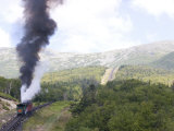Smoke Rises from the Steam Engine of the Cog Railway