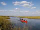 Sea Kayaker and Fisherman Paddles Through a Salt Water Marsh