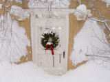 Snow Covered Christmas Wreath with a Bow Adorns a Door in Santa Fe