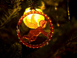 Backlit Cupid on a Very Old Christmas Ornament