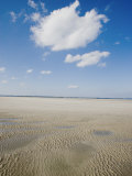 Clouds Above a Sandy Beach at Low Tide