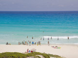 Crowd of People Enjoying a Perfect Day at a Beach in Cancun