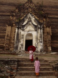 Young Burmese Girls Emerge from a Temple Carved in Rock