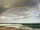 Rainbow Stretches across the Sky Above the Pacific Ocean in Hawaii
