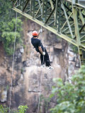 Man Repelling into the Iguacu Falls Canyon from a Bridge