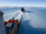 Hunter Traveling over the Wet Spring Ice in the Arctic