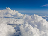 Looking Out of an Airplane Window at Cumulus Clouds at 32 000 Feet