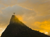 Christ the Redeemer Statue Atop Corcovado in Orange Glow at Sunset