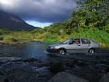 Crossing a Shallow River in a Car