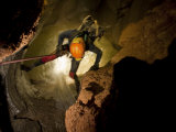 Caver Descending Through Water in Mcbride's Cave
