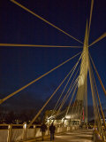 Pedestrians Cross the Modern Bridge at Night